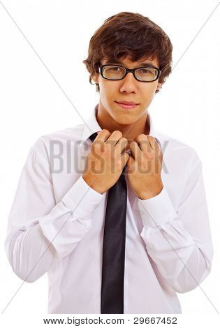 Handsome young brunet man in glasses standing and taking off white shirt with black tie isolated on white background. Mask included