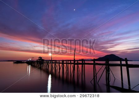 wooden pier on tropical Kanawa Island at dusk