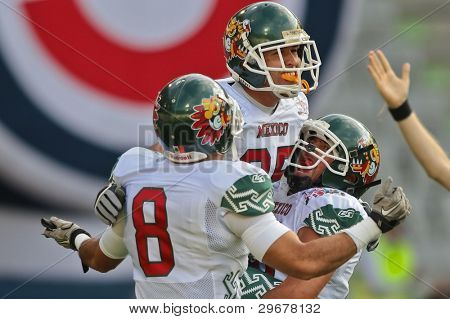 INNSBRUCK, AUSTRIA - JULY 8: WR Jose Alfonso (#8 Mexico) and WR Oscar Ruiz (#85 Mexico) celebrate after a touchdown at the Football World Championship on July 8, 2011 in Innsbruck, Austria.