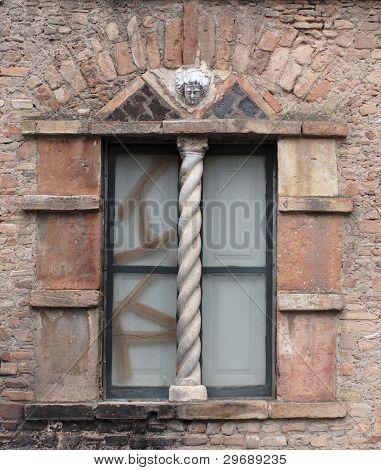 Broken window of old Medieval house