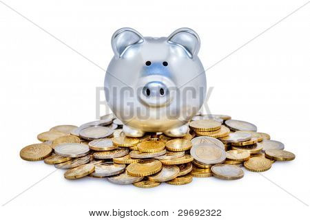 Shiny metal piggy bank on top of a pile of Euro coins.