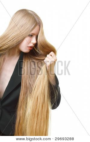portrait of beautiful girl with long unruly blond hair