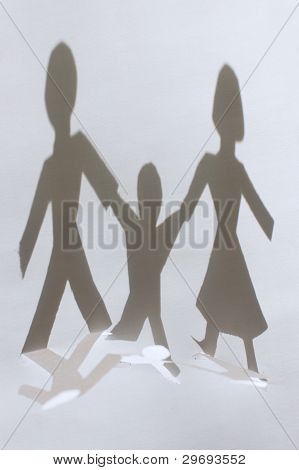Shadow From Paper People Chain: Man, Woman And Baby. Family Concept. Focus On Shadow.