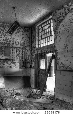 Doors, light, window. Inside an abandoned and decaying post office.
