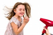 Girl Is Smiling At Blow Dryer - Hair Dryer. Little Girl Enjoying And Smiling At Blow Dryer Wind, Whe poster