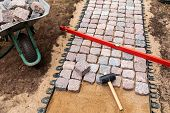 Landscaping And Garden Services - Granite Cobblestone Walkway Construction poster