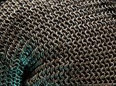 Armor Chain texture. Ring or chain steel mail armour background. Rows of chain mail rings as a textu poster