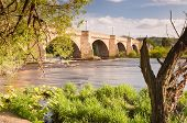 stock photo of tyne  - Bridge over the river Tyne leading into Corbidge village on a sunny spring day - JPG