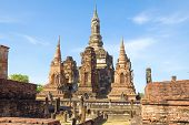 Central Chedi Of The Buddhist Temple Wat Mahathat In A Sunny Day. Sukhothai, Thailand poster