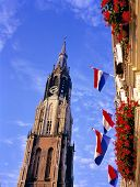 New Church And Flags At The Market Place In Delft.