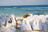 stock photo of playa del carmen  - Empty chairs awaiting a wedding on the beach at Playa del Carmen Mexico on the Atlantic Ocean - JPG