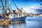A Weathered Fishing Boat Docked In The Inner Harbor In Lewis Bay In Hyannis Massachusetts On A Sunny poster
