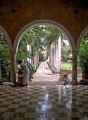 stock photo of hacienda  - Beautiful entry of archs and palm trees in 1800 century hacienda - JPG