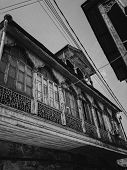Black And White Old Antique Balcony Of A Wooden European House. European Old Architecture. Vertical  poster
