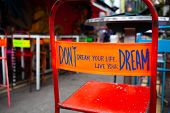 dont dream your life, live your dream - message on the back of a red chair poster