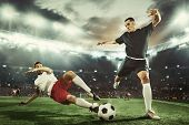 Two Caucasian Fit Active Men As Soccer Players Fighting With Ball At Stadium. Game Concept. Competit poster