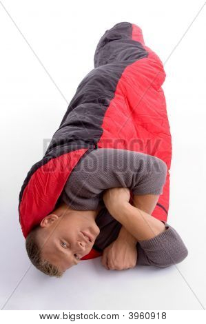 Young Man Covered Himself With Red Sleeping Bag