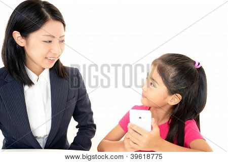 Smiling girl with smartphone