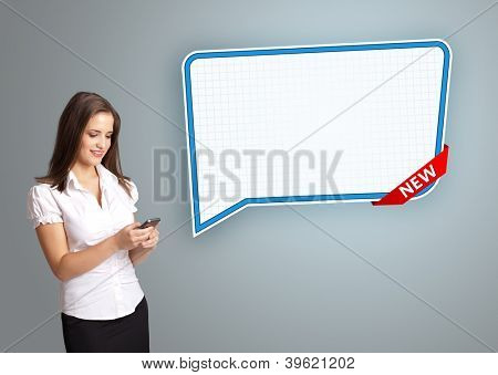 beautiful young woman holding a phone and presenting modern speech bubble copy space