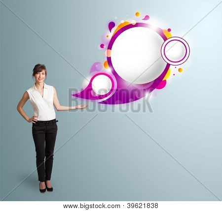 Attractive young woman presenting abstract speech bubble copy space