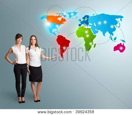 Beautiful young women presenting colorful world map