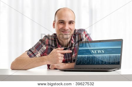 Young Man With Laptop. News Concept