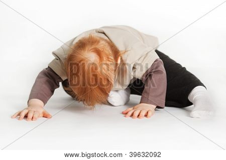 Child Laying On White Floor