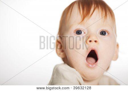 little boy yawns
