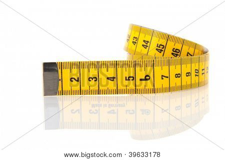 Rolled measuring lint isolated over white background with reflection