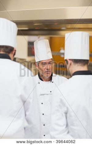 Head chef scolding employees in the kitchen