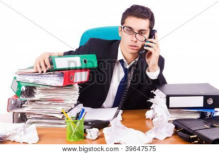 Busy stressed man in the office