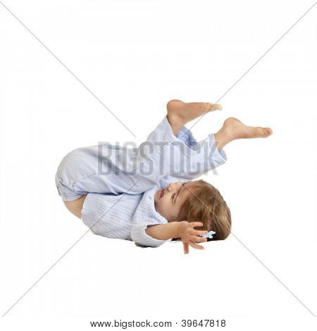 toddler girl doing somersault, isolated with clipping path.
