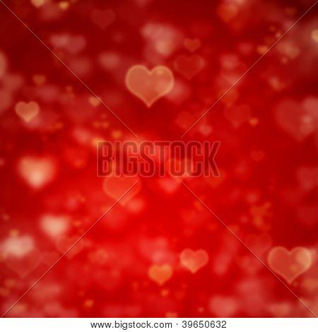 verwaschenes Rot Valentinstag Hintergrund mit Herzen