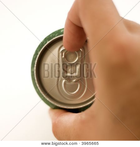 opening a soda can over white