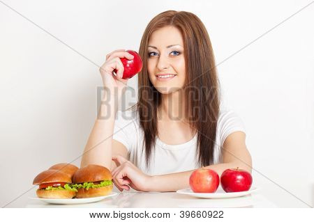 woman sitting behind the table with food