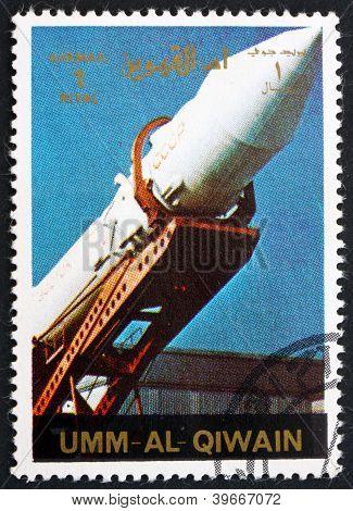 UMM AL-QUWAIN - CIRCA 1972: a stamp printed in the Umm al-Quwain shows A Soviet Rocket being Erected, History of Spaceflight, circa 1972