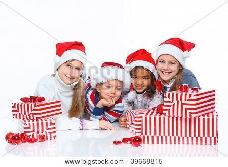 Happy kids in Santa's hat with gift box