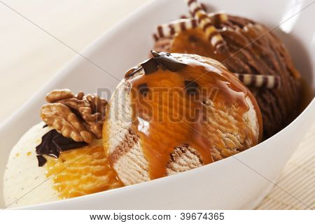 Three Scoops of Ice Cream with walnuts, chocolate chips and caramel topping