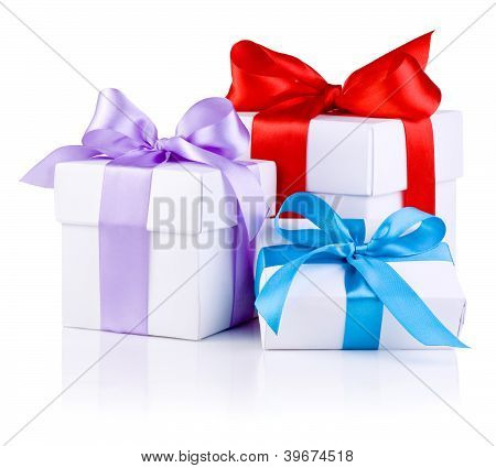 Three White Boxs Tied With Red, Purple And Blue Satin Ribbon Bow Isolated On White Background