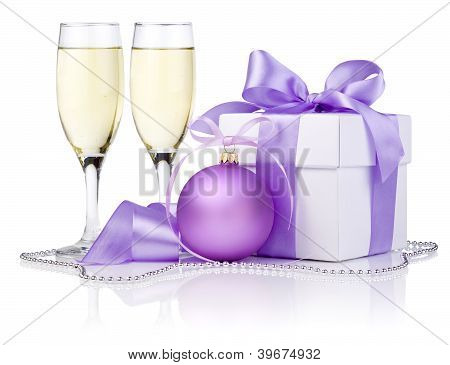 Christmas Gift With Purple Ball, Two Champagne Glass And Ribbon Bow Isolated On White Background