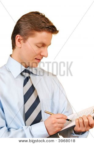 Young Businessman Taking Notes