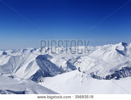 Panoramic View On Snowy Mountains In Nice Day