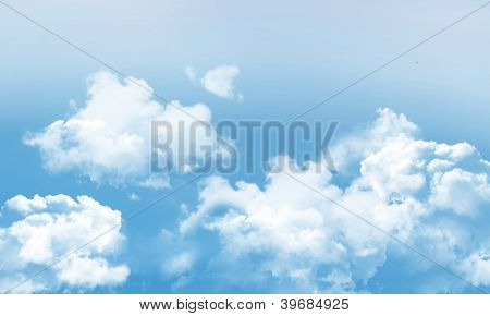Fluffy Clouds And Blue Sky