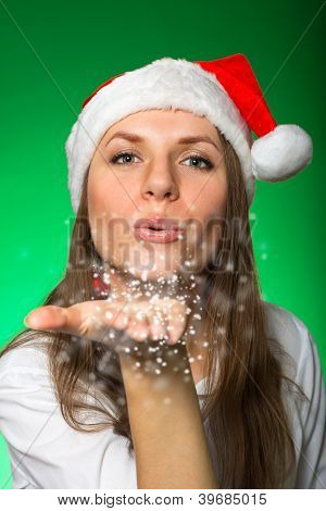 Girl In A Christmas Hat And Snowflakes
