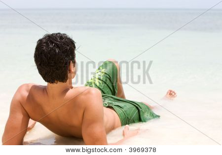 Man Relaxing At The Beach