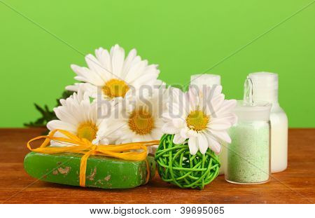 ingredients for soap making on green background