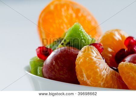 Dietetic, healthy fruit salad in the white bowl - healthy food concept