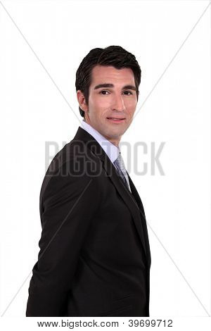 Haughty businessman on white background