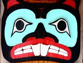 picture of indian totem pole  - Close up of a carved and painted totem pole - JPG