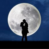 picture of adoration  - Close up of silhouette couple kissing on full moon at night - JPG